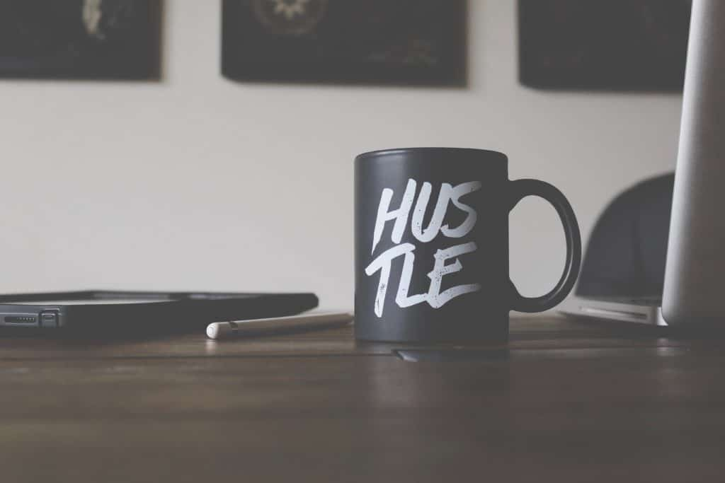A mug with the word HUSTLE. You just have to keep hustling if you want to see results!