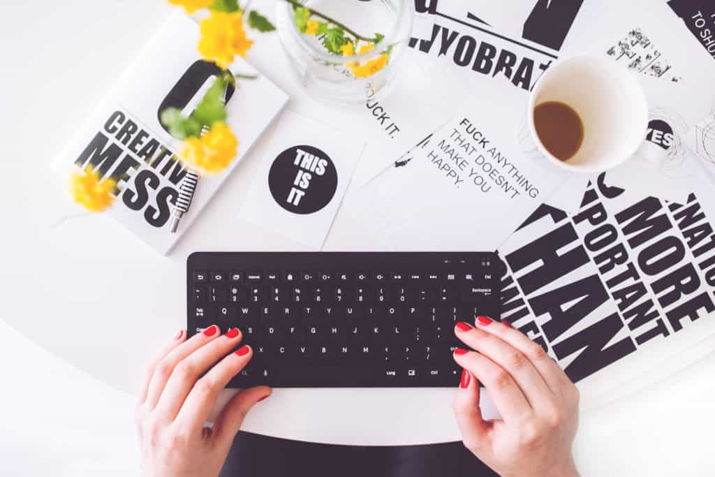Woman with keyboard and coffee. Get creative and make your own designs which can be applied to various products to sell!