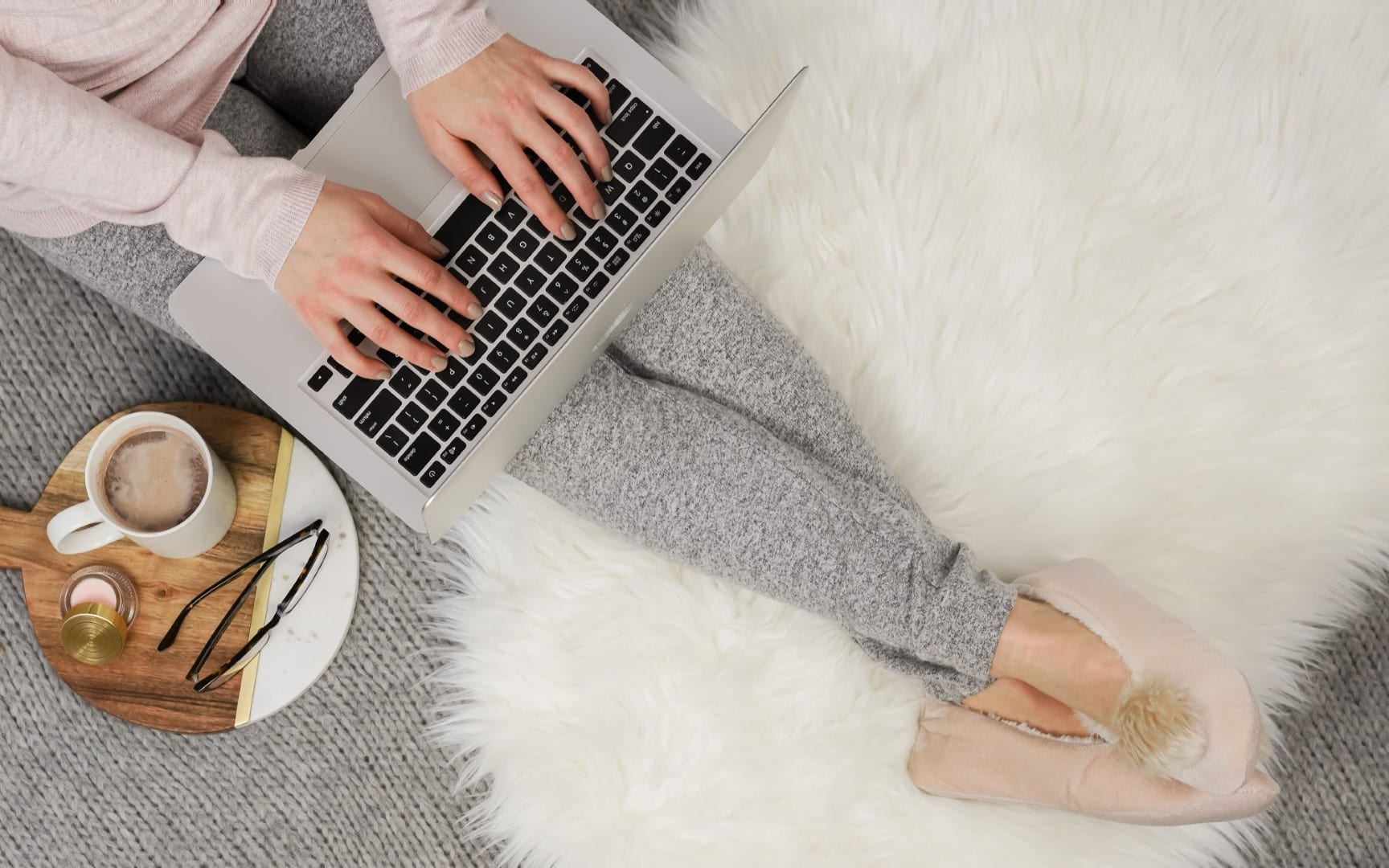 a blogger working on her laptop with tea