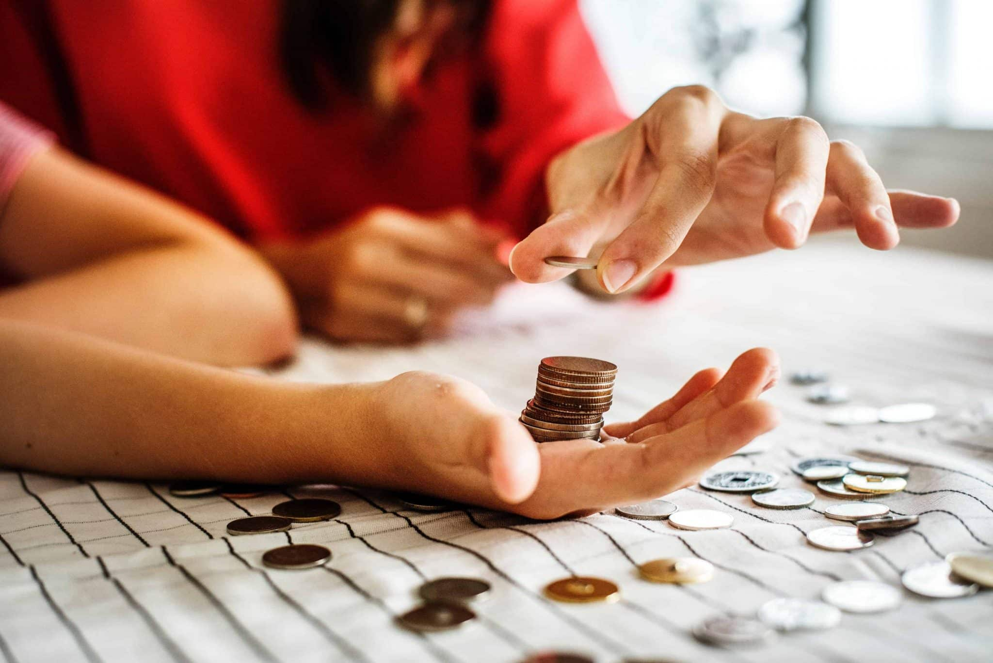 saving for a house - couple counting coins