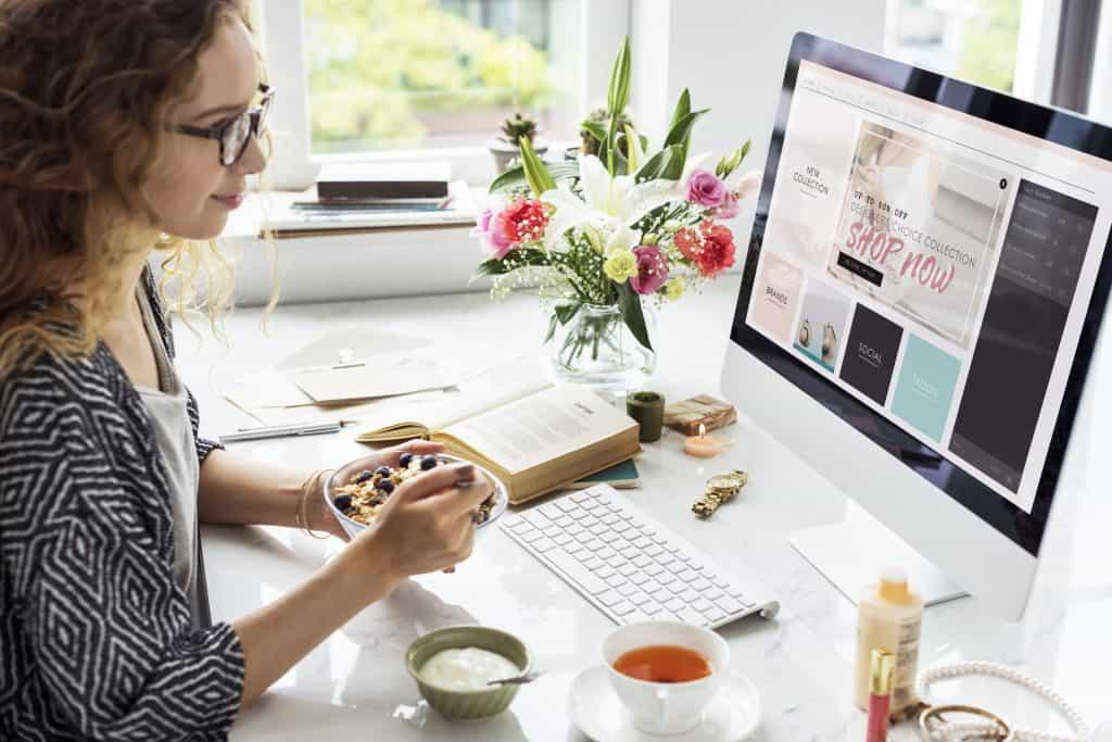 Woman making money online as a freelance Pinterest VA