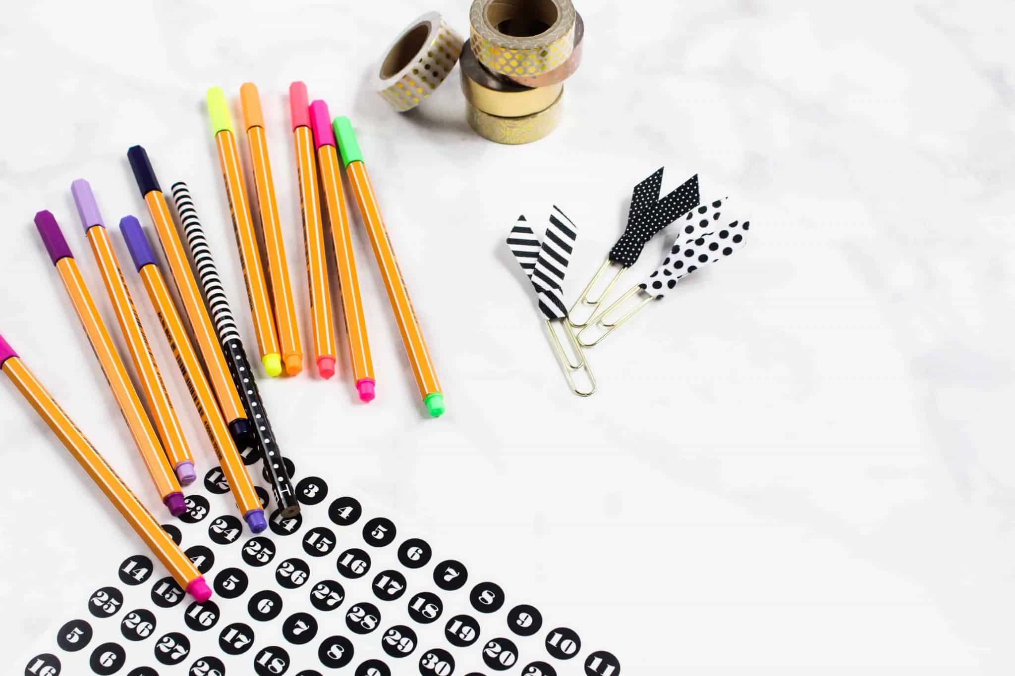 A desktop with coloured pens and tape. Think creatively and blog about what you love!