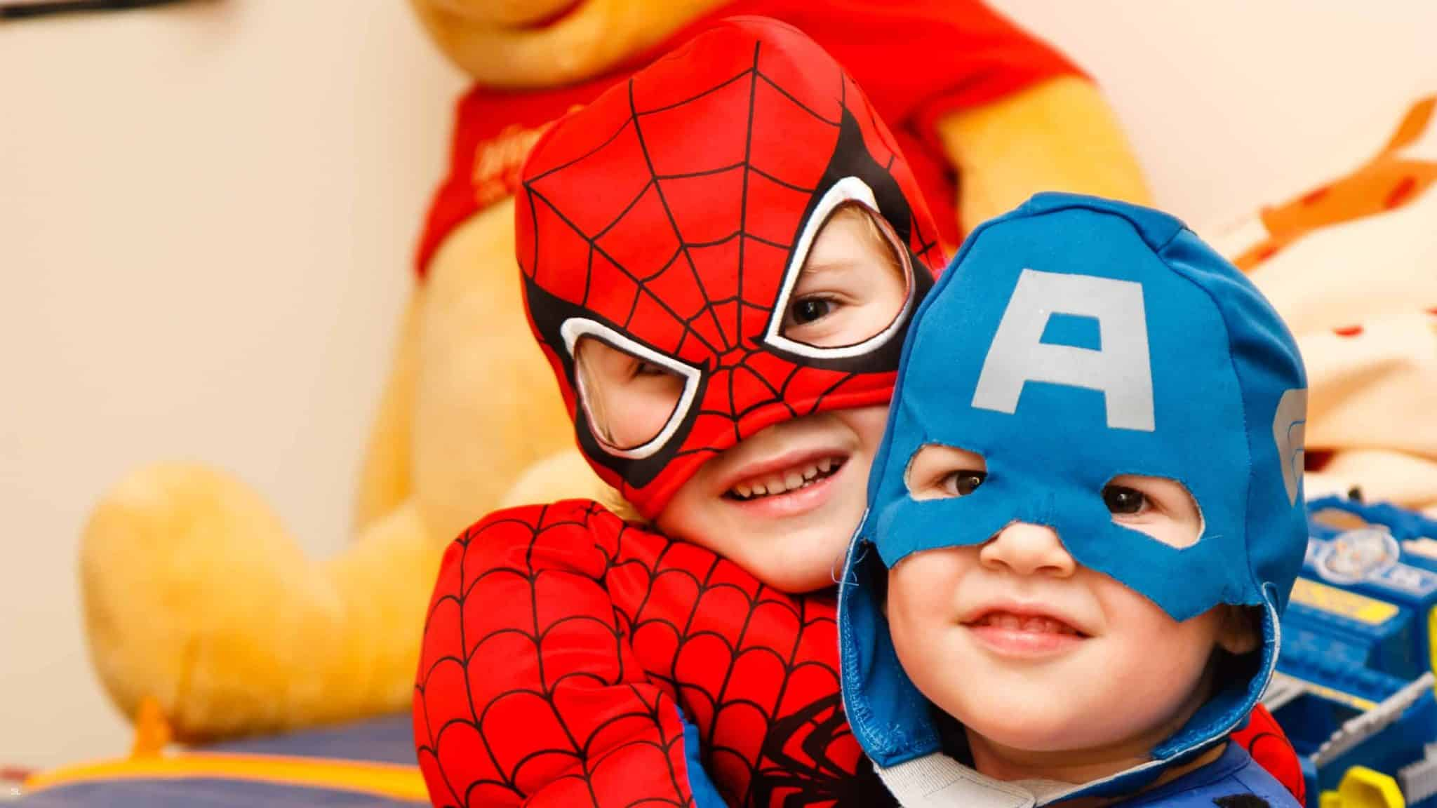 Two little boys in superhero costumes. Could you sew costumes like this as a side hustle?