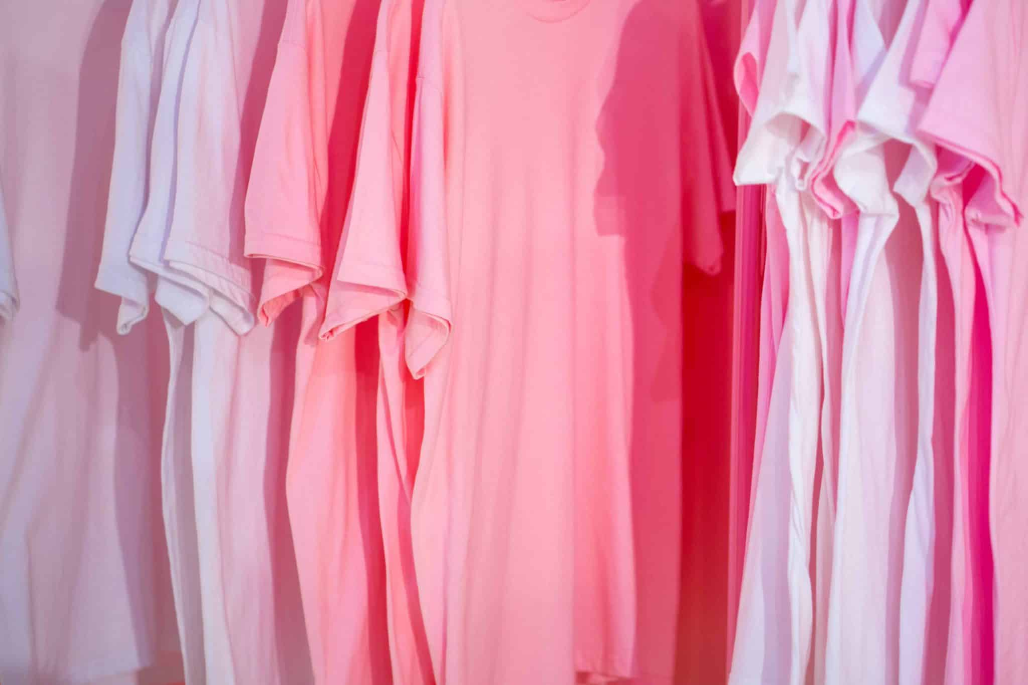 a row of pink t shirts. sell t shirts to make money online!