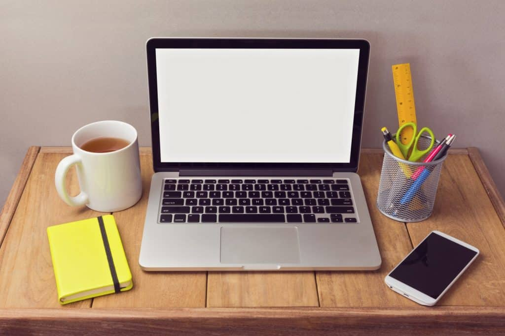 make money online in the UK: a laptop and coffee on a desk