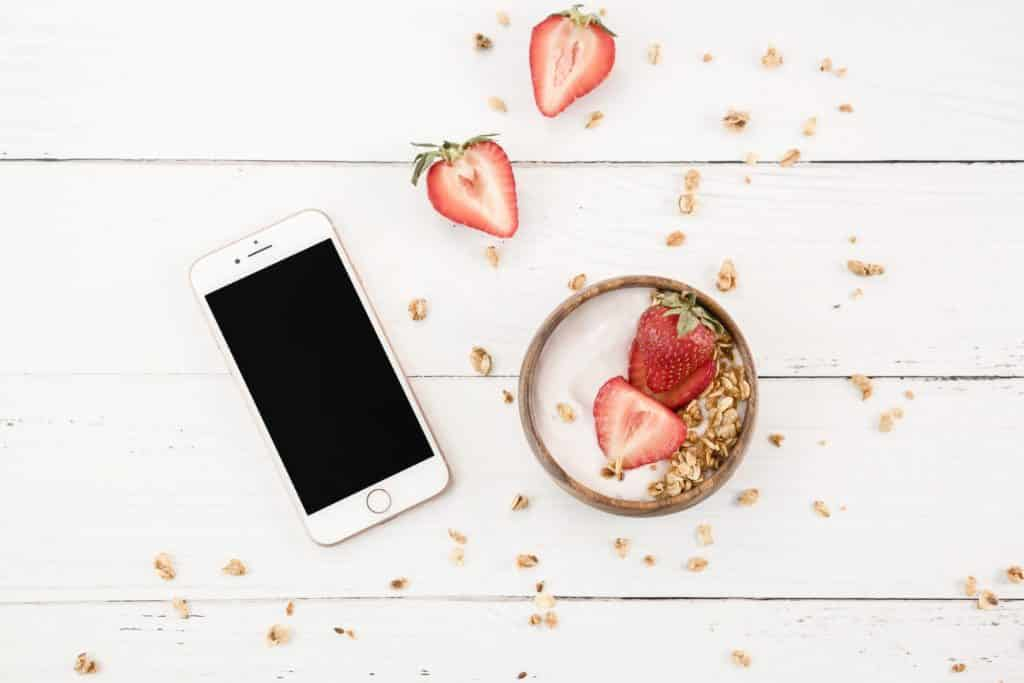 phone and strawberries on desk