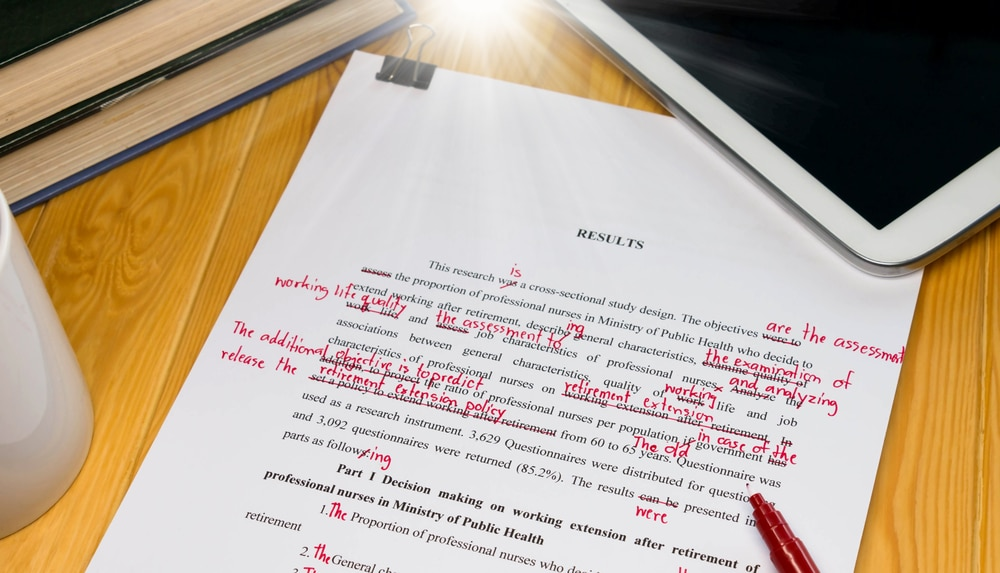 An essay marked with red pen. Proofreading is a good way to earn extra money, and you don't need particular qualifications.