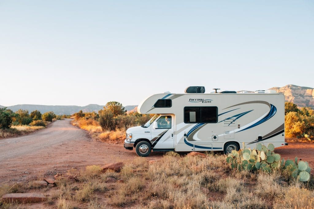 an RV vehicle parked in the desert