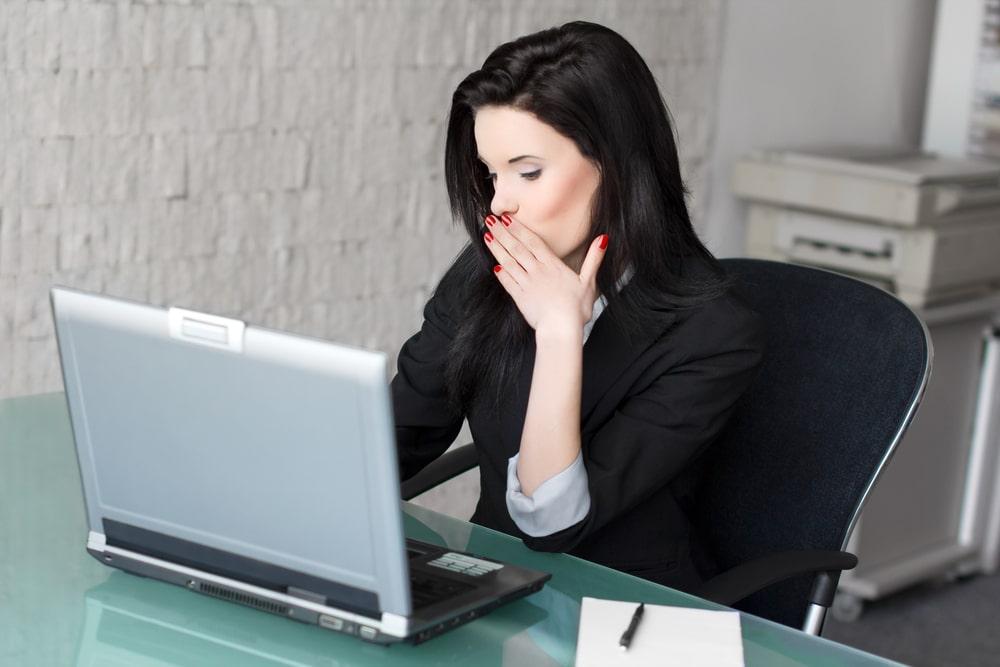 woman in black doing flirt chat on her laptop
